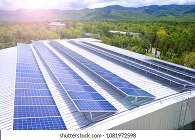 Solar panel on a white roof with cloud sky and mountain view. Lens flare picture.