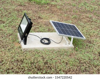 Solar panel for open spotlight on the field in the park.Solar cells help protect  the environment and energy saving.
