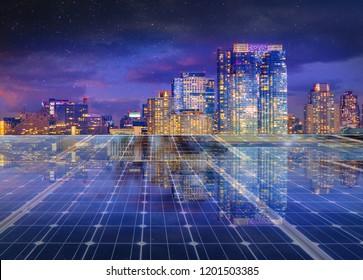 Solar panel over cityscape nightlight background. solar power green energy for life concept