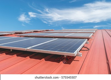 Solar panel pattern on red roof tile. Solar power.