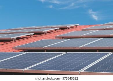 Solar panel pattern on red roof tile.Solar power.