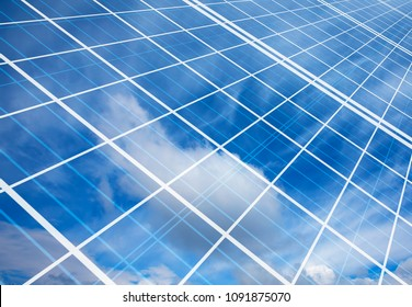 Solar Panel (Photovoltaic) with cloudy sky reflection