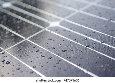 Solar panel with rain drops on a nano coating. Renewable energy from the sun, green power.