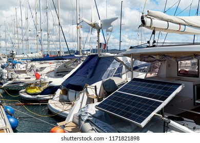 Solar panel, renewable energy on a moored docked yacht, boats, sailboats, motorboats, nautical vessels in the marina port of Ibiza Island. Technology, eco-friendly. Balearic Islands. Europe. Spain