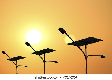 solar panel silhouette with golden sky and sunlight