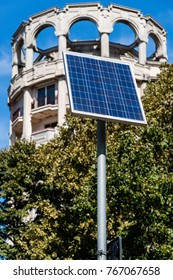 Solar panel supplies street sign and lighting in the city - alternative electricity source selective focus