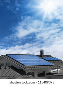Solar panel system on house roof, sunny blue sky background