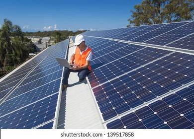 Solar panel technician on roof
