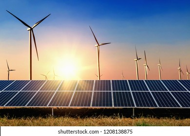 solar panel with turbine and sunset blue sky background. concept clean power energy