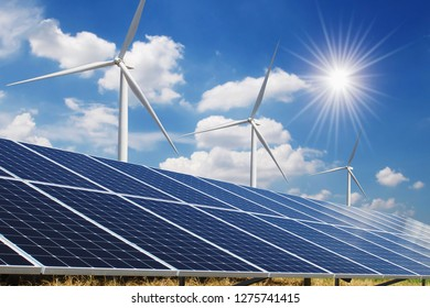 solar panel and wind turbine blue sky with sun background. concept clean power energy