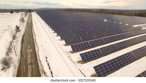 Solar panels aerial of photovoltaic field in late afternoon