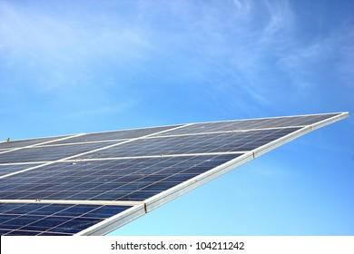 Solar panels against blue sky.