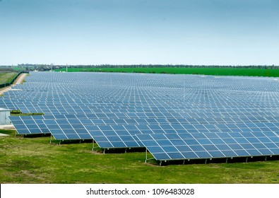 Solar panels against blue sky, Alternative electricity source. Concept of sustainable resources. Photovoltaic modules for renewable energy