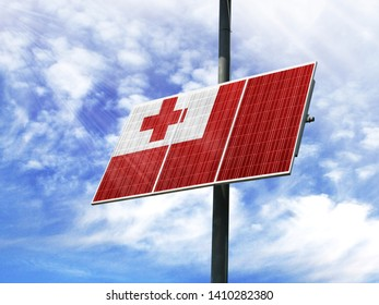 Solar panels against a blue sky with a picture of the flag of Tonga