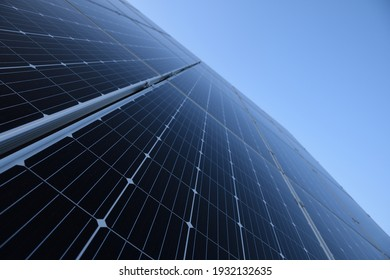 Solar panels against blue sky background.Against The Deep Blue Sky in a suny weather