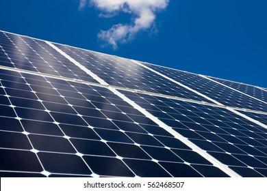Solar panels against blue sky background