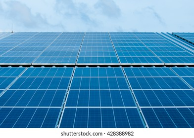 Solar Panels Against The Deep Blue Sky And Clouds. copy space for text