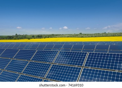Solar panels against a rapeseed field