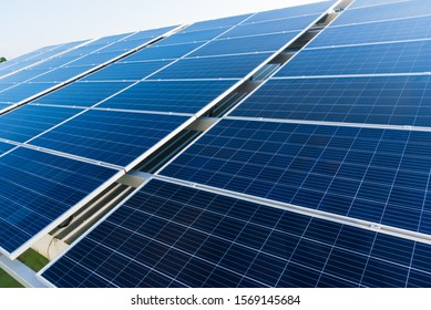 Solar panels and blue sky background.Solar cells farm on the roof.Photovoltaic modules for renewable energy.Save the earth and the energy with good environment concept.