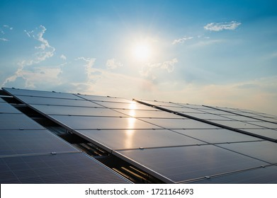 Solar panels and blue sky background.Solar cells farm on the roof and sunset.Photovoltaic modules for renewable energy.Save the earth and the energy with good environment.Warming global concept.