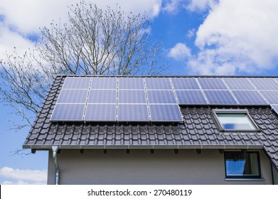 solar panels with blue sky on the house roof