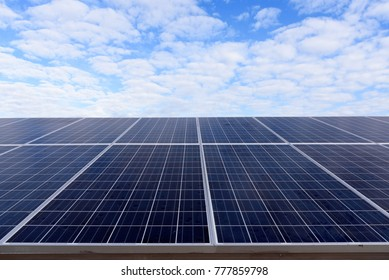 Solar panels with blue sky with the sunny sky. Photovoltaic modules for renewable energy.Save the earth concept.