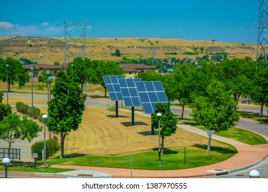 Solar Panels by a Street in a Residential Area with High Voltage Lines in the Background