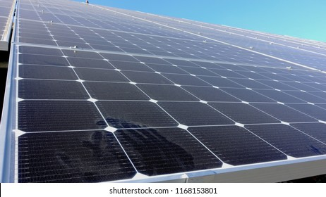 Solar panels in California industrial park are dusty and dirty after a long summer without rain and in need of cleaning