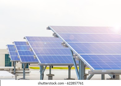 Solar panels or Solar cells on factory rooftop or terrace with sun light, Industry in Thailand, Asia. Can saving energy. Sun or renewable or Clean energy concept.