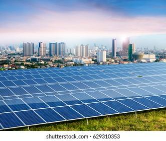 Solar panels, city on background,  Ecological energy renewable solar panel plant
