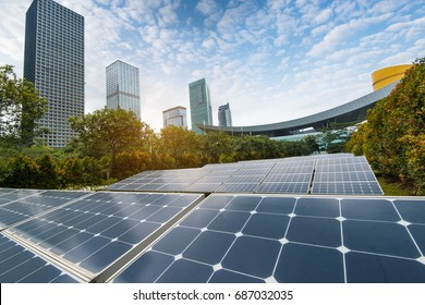 solar panels with cityscape of modern city