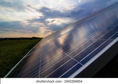 Solar panels closeup on sunset background