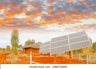 Solar panels in desert under colorful sunset sky clouds, sun energy and electricity generation in Africa. Investment project to reduce greenhouse gas emissions