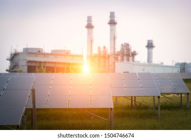 Solar panels and Electric power plant by gas background.