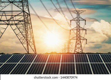 Solar panels with electricity pylon and sunset. Clean power energy concept