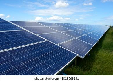 Solar panels energy farm on sky background.