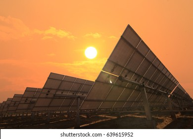 solar panels face sunlight with sky warm
