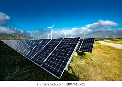 Solar panels farm under the sky. Blue solar panels. Background of photovoltaic modules for renewable energy clean energy green energy to prevent climate change and global warming