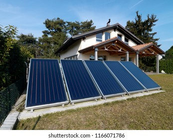 solar panels in the garden of a modern villa