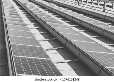 Solar panels installed on the office building. Edited in black and white