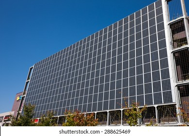 Solar panels installed on the outer wall of commercial buildings