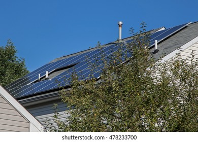 Solar panels installed on a roof of a private home.