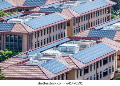 Solar panels installed on the tiled rooftops of buildings, San Francisco bay area, Silicon Valley, California
