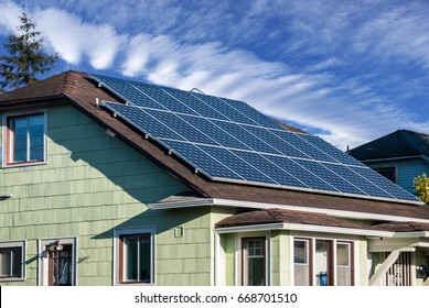 Solar panels installed and in use on the roof of a house.