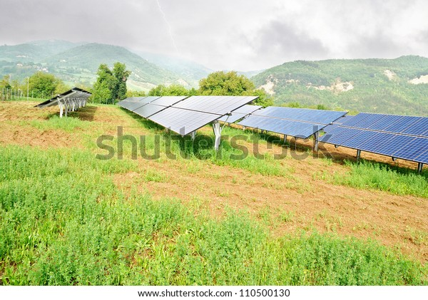 solar panels in mountain under cloudy sky