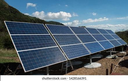 Solar panels mounted against a blue sky