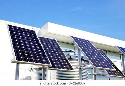 Solar panels on blue sky background