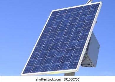 Solar panels on bright blue sky background. Renewable Energy. Horizontal shot