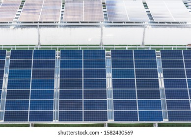 Solar panels on the building or house.Solar cells farm on the roof.Photovoltaic modules for renewable energy.Save the earth and the energy with good environment concept.