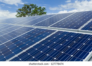 Solar panels on factory roof.